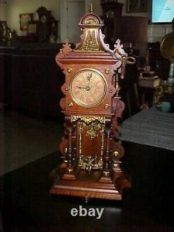 VERY RARE 1900's LENZKIRCH MINI FRONT TO BACK CUPID SWINGER CARVED WALNUT CLOCK